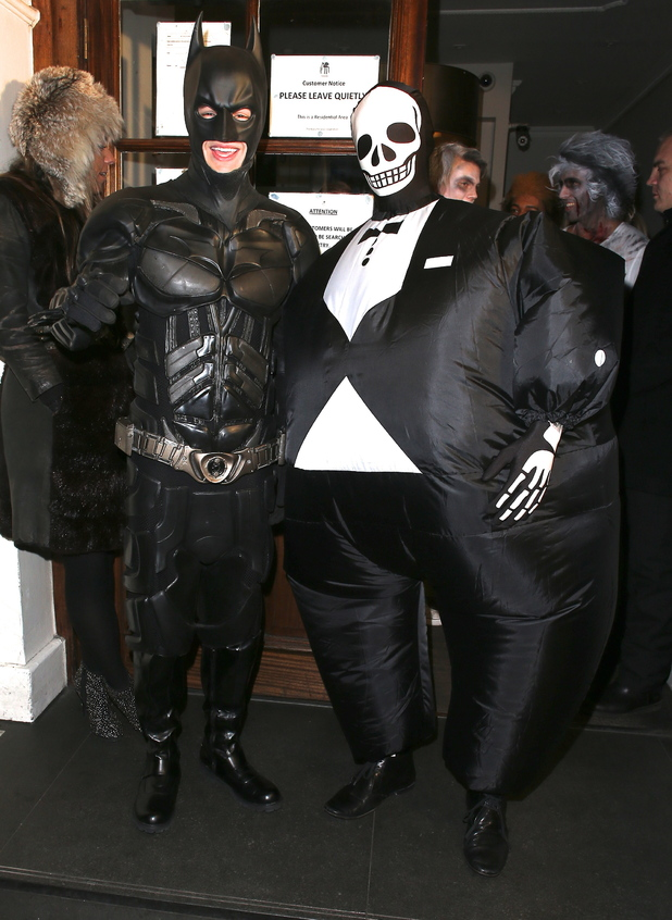 Liam Payne of One Direction dressed as Batman and Tom Daley in a fat skeleton costume Celebrities at Funky Buddha nightclub for a Halloween party