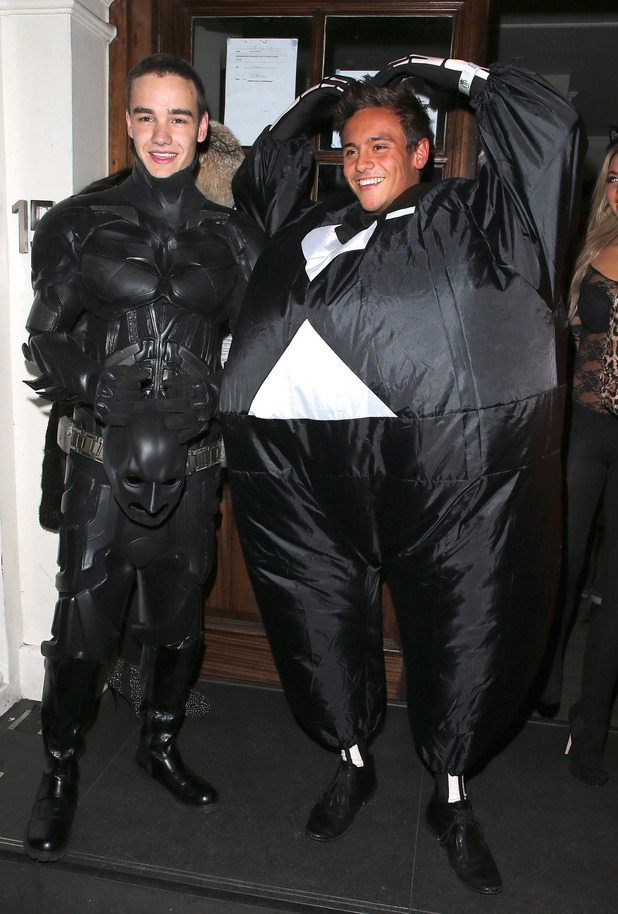 Liam Payne of One Direction dressed as Batman and Tom Daley in a fat skeleton costumeCelebrities at Funky Buddha nightclub for a Halloween partyLondon, England