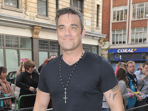 Robbie Williams arriving at the Radio 1 studios.