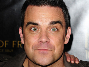 Robbie Williams before he switches on the Oxford Street lights