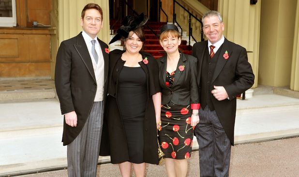 Actor Kenneth Branagh arrives with his wife Lindsay his brother Bill and sister-in-law Joyce, to be Knighted by Queen Elizabeth II at an Investiture Ceremony, at Buckingham Palace in central London.