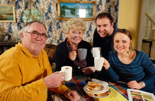 Jack Duckworth [Bill Tarmey], Vera Duckworth [Liz Dawn], Molly Compton [Vicky Binns] and Tyrone Dobbs [Alan Halsall] toast to Jack and Vera's new life in