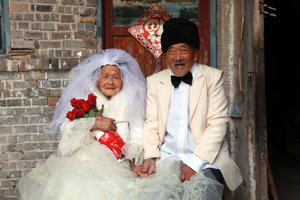 Chinese couple - combined age of 204 - pose for wedding photo