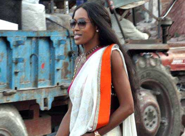 Naomi Campbell walks dressed in an Indian outfit during birthday celebrations of her boyfriend Russian billionaire Vladimir Doronin