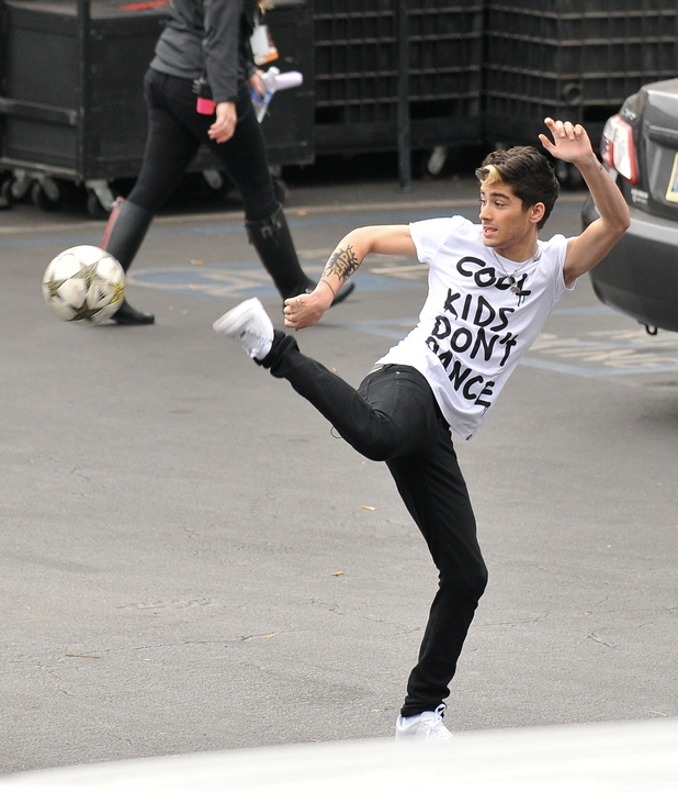 Zayn MalikOne Direction band members playing soccer in the parking lot of the X Factor Studio before rehearsing for their performance for tonight's elimination show