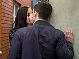 Joey and Lauren steal a kiss in the alleyway, despite the risk that someone might see them.