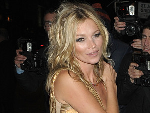Kate Moss in a gold dress at party for her new book &#39;The Kate Moss Book&#39; at 50 St James
