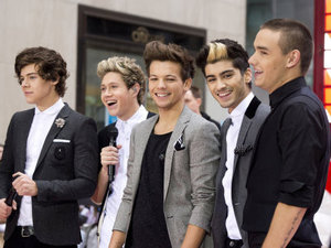 "One Direction members, from left, Harry Styles, Niall Horan, Louis Tomlinson, Zayn Malik and Liam Payne perform on NBC's ""Today"" show on Tuesday, Nov. 13, 2012 in New York. (Photo by Charles Sykes/Invision/AP)"