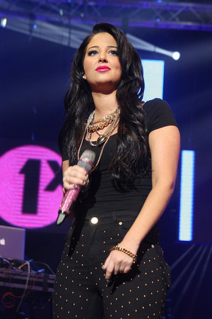 Tulisa performs on stage at BBC Radio 1Xtra Live at Brixton Academy in London.