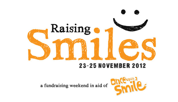 Raising Smiles logo