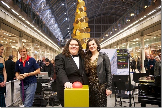 Jonathan & Charlotte turn on the Christmas tree light in St. Pancras International, London.