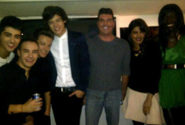 Priyanka Chopra poses with Simon Cowell and One Direction after appearing on the US X Factor