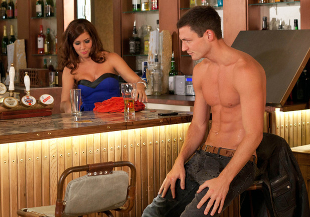 Maxine tries to clean up Liam's shirt.