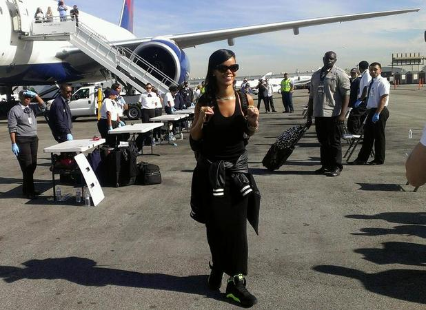 Rihanna boards plane for 777 tour