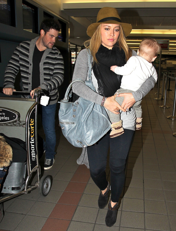 Mike Comrie, Hilary Duff and Luca Cruz Comrie Hilary Duff arrives at LAX airport to catch a flight with her husband and their son Los Angeles, California - 15.11.12
