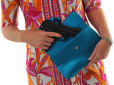 Woman with a pistol in her handbag