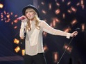 Taylor Swift performs on results show as another two acts leave the competition.