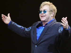Elton John greets the audience during his concert at Mercedes-Benz Arena in Shanghai.