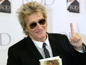 Rod Stewart greets fans at a book signing for Rod: The Autobiography.