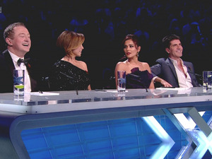 Louis Walsh, Cheryl Cole and Simon Cowell do not stand up or applaud after Jamiroquai performance on the 'X Factor' Results and Cheryl Cole and Dannii Minogue give each other a look. Seen on ITV. England - 31.10.10
