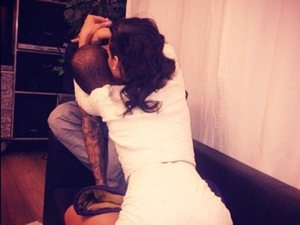 Rihanna and Chris Brown hugging after a concert, Twitter photo