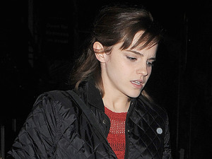 Emma Watson appears rather camera-shy as she walks to her waiting car in Soho.