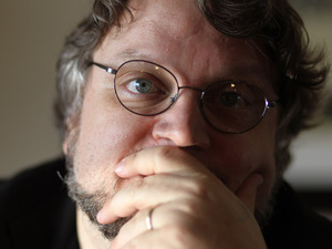 Director Guillermo del Toro, from the film &quot;Pacific Rim&quot;, poses for a portrait during Comic-Con, Saturday, July 14, 2012, in San Diego.