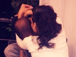 Rihanna uploads an image of herself hugging Chris Brown.