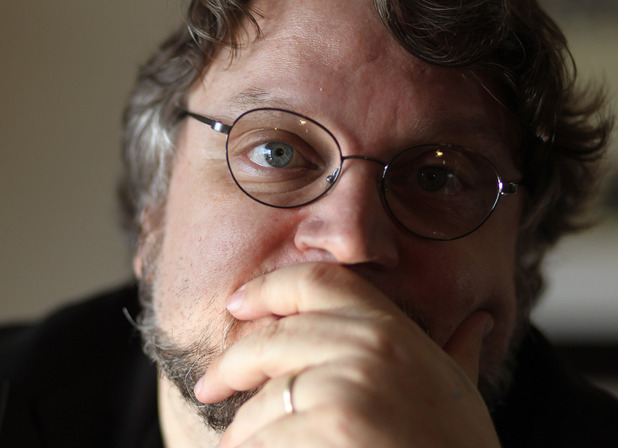 "Director Guillermo del Toro, from the film ""Pacific Rim"", poses for a portrait during Comic-Con, Saturday, July 14, 2012, in San Diego."
