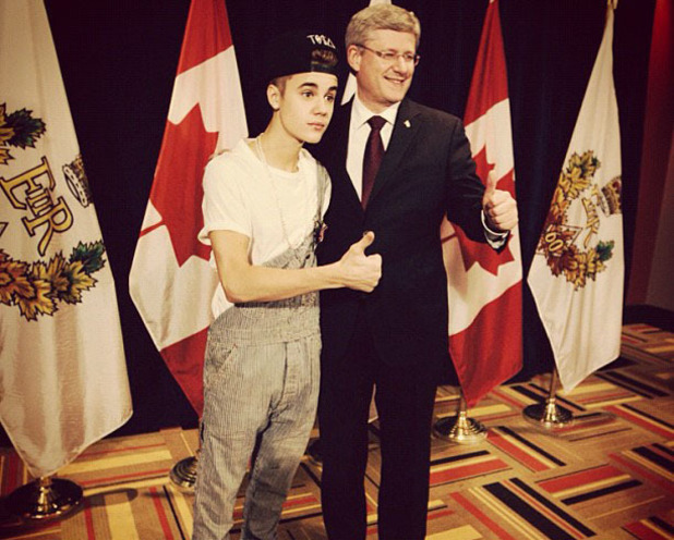 Justin Bieber posted this image posing with Canadian Prime Minister Stephen Harper to Instagram with the caption 'I met the Prime Minister in overalls lol'