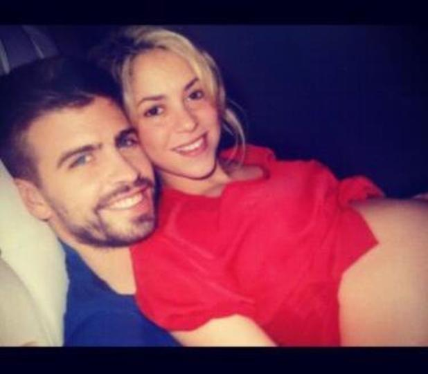 Shakira showing off her baby bump with boyfriend Gerard Piqué