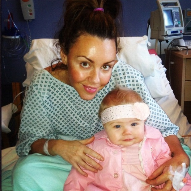 Michelle Heaton in hospital with her daughter Faith after undergoing a double mastectomy.