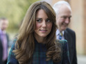 Kate Middleton looks pretty in tartan as she returns to prep school.