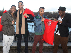 JLS hand out Christmas presents to fans on the South Bank in London as they launch the JLS Foundation for Cancer Research UK.