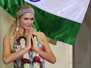 "Paris Hilton gestures with a traditional Indian greeting ""namaste"" during her visit to Ashray, an orphanage in Mumbai, India, Monday, Dec. 3, 2012."