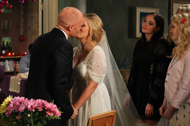 Max and Tanya share a kiss.