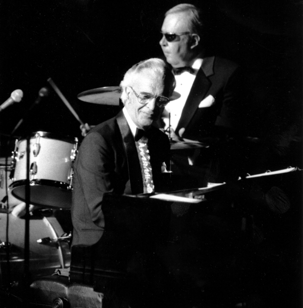 "Dave Brubeck sits at the piano during a performance of ""The Musical Life of Dave Brubeck"" at New York's Avery Fisher Hall on June 22, 1985. At the drums in rear is Joe Morello."