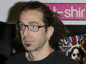 Randy Blythe is accused of pushing a fan off stage during a gig.
