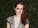 Kristen Stewart wears plunging dress to the 2012 Academy Governors Awards.