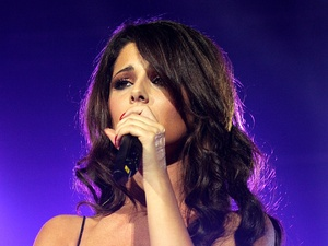 Cheryl Cole performing with Girls Aloud at the Capital FM Jingle Bell Ball