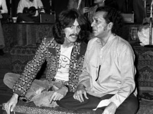 Ravi Shankar and George Harrison of The Beatles photographed together in 1974.