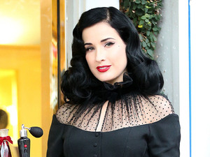 Dita Von Teese attends a pre-Christmas promotional event for her new perfume at Fred Segal in West Hollywood