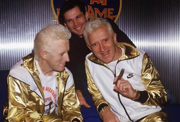 Jimmy Savile in a gold tracksuit alongside his waxwork