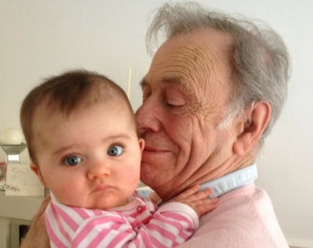 Alex Reid posts picture of his father with baby Dolly.