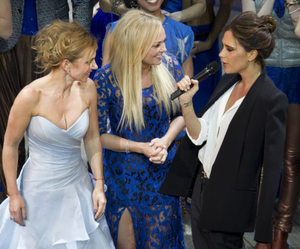 From left, Geri Halliwell, Emma Bunton, and Victoria Beckham take the applause on stage at the curtain call for Viva Forever! Press Night, a musical based on the songs of the Spice Girls, at the Piccadilly Theatre in central London, Tuesday, Dec. 11, 2012. (Photo by Joel Ryan/Invision/AP)