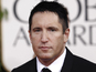 "Trent Reznor tweets ""f**k you"" to Grammys"