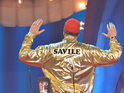 Sacha Baron Cohen reprises Staines character wearing controversial gold outfit.