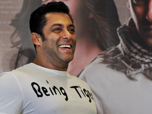 Salman Khan smiles as he stands in front of a poster showing himself and actress Katrina Kaif at a press conference to promote the film &#39;Ek Tha Tiger&#39; or &#39;Once There was a Tiger&#39;, in New Delhi, India, Sunday, August 12, 2012. 