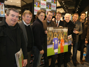 Keith Mullin from The Farm, Kenny Dalglish, John Bishop, Peter Hooton from The Farm, Steve Rotherham MP, Mike McCartney, Phil Thompson, Andy Brown from Lawson and Carl Hunter from The Farm, pose for photographers during the launch of 'The Justice Collective: He Ain't Heavy...' single at HMV in Liverpool