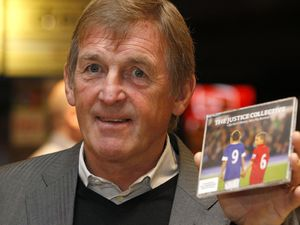 Former Liverpool manager Kenny Dalglish holds a copy of 'The Justice Collective: He Ain't Heavy...' during its official launch at HMV in Liverpool